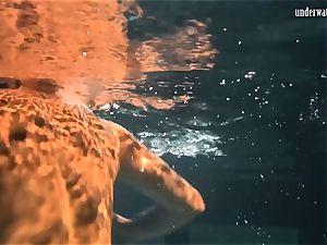 Lozhkova in observe thru cut-offs in the pool