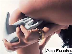 Asa Akira uses a fake forearm to please her cunt