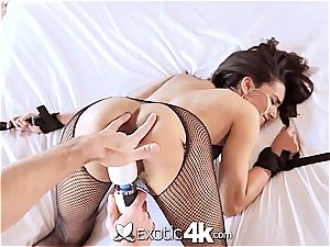 Latina Adrian Hush gets strapped onto the couch in nothing but a fishnet